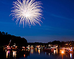 An evening flotilla forms every 4th of July to enjoy the impromptu fireworks displays put on by residents and boat owners at Lake Thoreau in Reston, Virginia, USA.