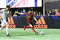 """ATLANTA, GA - MARCH 07: ATLANTA, GA - MARCH 07: Atlanta United midfielder Gonzalo """"Pity"""" Martinez passes the ball during the match against FC Cincinnati, which Atlanta won, 2-1, in front of a crowd of 69,301 at Mercedes-Benz Stadium during a game between FC Cincinnati and Atlanta United FC at Mercedes-Benz Stadium on March 07, 2020 in Atlanta, Georgia."""