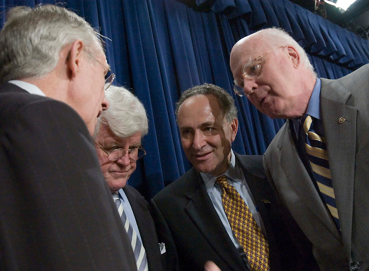 06/22/05.SENATE DEMOCRATS URGE BUSH TO CONSULT THEM ON NEXT SUPREME COURT NOMINEE--Senate Minority Leader Harry Reid, D-Nev., Sen. Edward M. Kennedy, D-Mass., Sen. Charles E. Schumer, D-N.Y., and Sen. Patrick J. Leahy, D-Vt., huddle before a news conference urging President Bush to consult them regarding who he should nominate should there be a vacancy on the Supreme Court. The ailing Chief Justice William H. Rehnquist is widely expected to retire at the end of the term. .CONGRESSIONAL QUARTERLY PHOTO BY SCOTT J. FERRELL