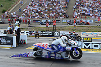 Jul, 22, 2012; Morrison, CO, USA: NHRA pro stock motorcycle rider Hector Arana Jr (near lane) races alongside Eddie Krawiec during the Mile High Nationals at Bandimere Speedway. Mandatory Credit: Mark J. Rebilas-