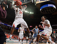 Virginia forward Akil Mitchell (25) saves the ball during an NCAA basketball game against Virginia Monday Jan. 20, 2014 in Charlottesville, VA. Virginia defeated North Carolina 76-61.