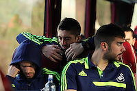 Wednesday 26 February 2014<br /> Pictured L-R: Jose Canas, Pablo Hernandez and Jordi Amat  on the coach en route to Cardiff Airport.<br /> Re: Swansea City FC travel to Italy for their UEFA Europa League game against Napoli.