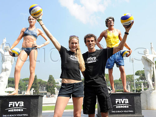 16 06 2011 Beach volleyball FIVB World Cup 2011 Rome Italy  Beach Volleyball FIVB World Championships Photo call Picture shows Kerri Walsh USA and Emanuel BRA next to their Statues