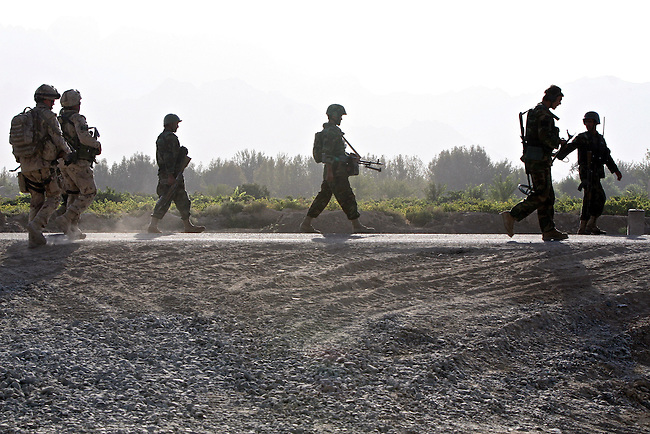 Canadian soldiers and Afghan troops head out on patrol near the village of Pashmul in Zhari district, Kandahar province, Afghanistan. The soldiers fight daily skirmishes with insurgents for control of Zhari, where the hardline Taliban movement first originated in the early 1990s. Sept. 29, 2008. DREW BROWN/STARS AND STRIPES