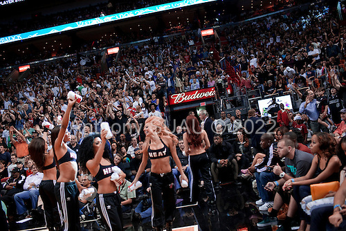Miami, Florida<br /> January 29, 2012<br /> <br /> Miami HEAT Dancers work the crowd during a break as the BULLs close a ten point lead held by the Miami HEAT in the final quarter of the game.
