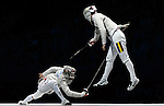 LONDON, ENGLAND - AUGUST 3:  Eunseok Oh of South Korea competes against Florin Zalomir of Romania during the Men's Fencing Team Sabre Bronze and Gold  Medal Final Day 7 of the London 2012 Olympic Games on August 3, 2012 at the Excell Center in London, England. (Photo by Donald Miralle)