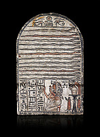 "Ancient Egyptian stele dedicated to Meretsesger, limestone, New Kingdom, 19th Dynasty, (1279-1213 BC), Deir el-Medina, Egyptian Museum, Turin. black background.<br /> <br /> The stele is divided into 3 registers. In the top section 2 wedjat eyes with shen sign above 3 zigzag lines indicating water are depicted. The second, largest register, is divided into 12 horizontal strips. Each is occupied by a coloured snake facing to the right.In the bottom register 3 columns of hieroglyphic text worship the goddess Meretseger: ""life, strength and health to the ka and the lady of the house Wab, the justified."" To the right of the text the deceased woman is kneeling with her hands raised in adoration. She  wears a white robe. A lotus flower is placed on top of her wig. Behind her head there are 4 hieroglyphic signs that form the phrase ""at peace"". To the right of the scene there is an offering table with a vessel flanked by a bunch of lotus flowers. Below the table there are 2 vessels on pedestals."