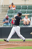 Nolan Early (9) of the Kannapolis Intimidators follows through on his swing against the Lakewood BlueClaws at CMC-NorthEast Stadium on July 20, 2014 in Kannapolis, North Carolina.  The Intimidators defeated the BlueClaws 7-6. (Brian Westerholt/Four Seam Images)