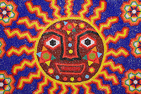 Detail of Huichol Indian beadwork painting decorated with sun abd peyote buttons, Mexico