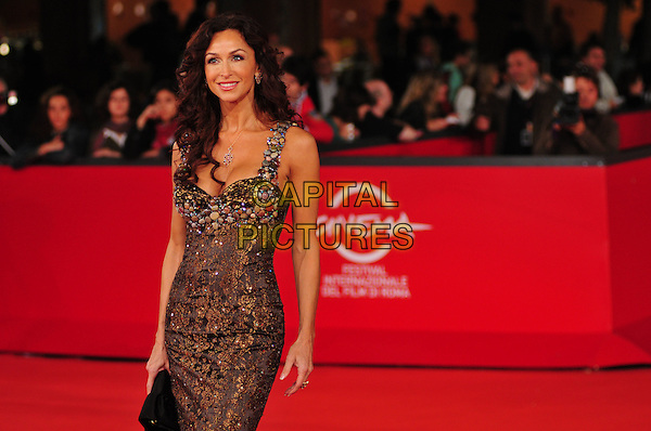 "SOPHIA MILOS .The ""8"" Premiere during the 3rd Rome International Film Festival, Auditorium Parco della Musica, Rome, Italy..October 23rd, 2008.eight half length black clutch bag brown dress beads beaded .CAP/CAV.©Luca Cavallari/Capital Pictures."