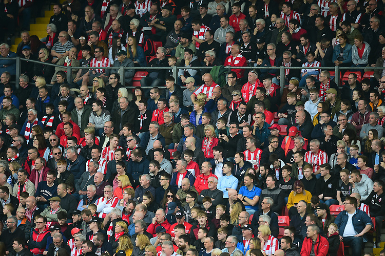 Lincoln City fans watch their team in action<br /> <br /> Photographer Andrew Vaughan/CameraSport<br /> <br /> The EFL Sky Bet League Two - Lincoln City v Macclesfield Town - Saturday 30th March 2019 - Sincil Bank - Lincoln<br /> <br /> World Copyright © 2019 CameraSport. All rights reserved. 43 Linden Ave. Countesthorpe. Leicester. England. LE8 5PG - Tel: +44 (0) 116 277 4147 - admin@camerasport.com - www.camerasport.com
