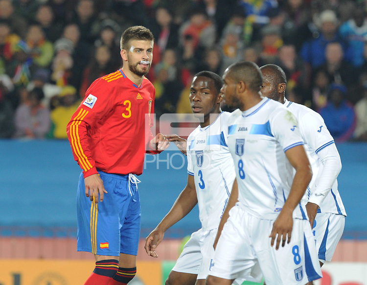 Spanish defender Gerard Pique, showing the signs of a physical match, positions for a set piece. Spain defeated Honduras, 2-0, in their second match of play in Group H  in a match played Monday, June 21st, at Ellis Park in Johannesburg, South Africa at the 2010 FIFA World Cup..