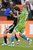 D.C. United midfielder Nick DeLeon (18) shields the ball against Seattle Sounders midfielder Osvalo Alonso (6) D.C. United tied the Seattle Sounders, 0-0 at RFK Stadium, Saturday April 7, 2012.