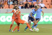 Houston, TX - Friday April 29, 2016: Becca Moros (4) of the Houston Dash attempts to steal the ball from Tasha Kai (32) of Sky Blue FC at BBVA Compass Stadium. The Houston Dash tied Sky Blue FC 0-0.