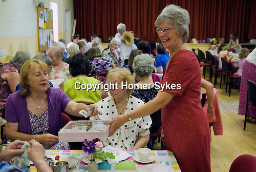 Stowey Female Friendly Society ( The Womens Walk ) Club Day. £5.00 Cream Tea, Liz Grandfield makes the collection. Nether Stowey Somerset UK 2014.