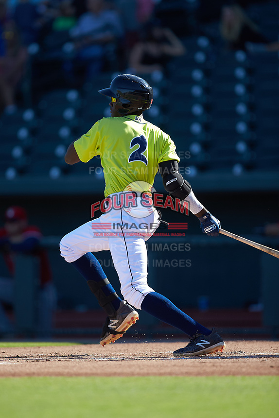 Ronny Mauricio (2) of the Columbia Fireflies follows through on his swing against the Rome Braves at Segra Park on May 13, 2019 in Columbia, South Carolina. The Fireflies walked-off the Braves 2-1 in game one of a doubleheader. (Brian Westerholt/Four Seam Images)