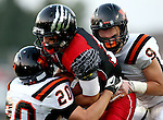 BRANDON, SD - SEPTEMBER 26: Drew Reinschmidt #12 from Brandon Valley is wrapped up by Cole Uithoven #20 and Zach Devries #9 from Washington in the first quarter of their game Friday night in Brandon.  (Photo by Dave Eggen/Inertia)