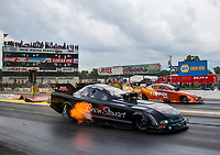 Aug 18, 2017; Brainerd, MN, USA; NHRA funny car driver Brian Stewart (near) races alongside Dale Creasy Jr during qualifying for the Lucas Oil Nationals at Brainerd International Raceway. Mandatory Credit: Mark J. Rebilas-USA TODAY Sports