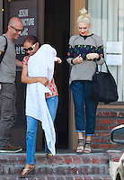 LOS ANGELES, CA - MAY 28: Gwen Stefani's nanny seen holding her son Apollo, while leaving her acupuncturist in Korea Town in Los Angeles, California on May 28, 2014. SP1/Starlitepics