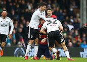 17th March 2018, Craven Cottage, London, England; EFL Championship football, Fulham versus Queens Park Rangers; Aleksandar Mitrovic of Fulham lunges at Pawel Wszolek of Queens Park Rangers as both players tussle on the pitch with Lucas Piazon of Fulham attempting to separate both players