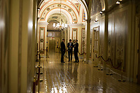 Senate Staffers speak with each other on the first floor of the United States Capitol Building in Washington, DC on Friday, December 1, 2017. <br /> Credit: Alex Edelman / CNP /MediaPunch