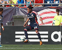New England Revolution midfielder Lee Nguyen (24) attempts to control the ball. In a Major League Soccer (MLS) match, the New England Revolution (blue) defeated LA Galaxy (white), 5-0, at Gillette Stadium on June 2, 2013.