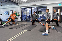 (L-R) Courtney Baker-Richardson, Matt Grimes, George Byers and Jay Fulton exercise in the gym during the Swansea City Training Session at The Fairwood Training Ground, Swansea, Wales, UK. Thursday 27 September 2018