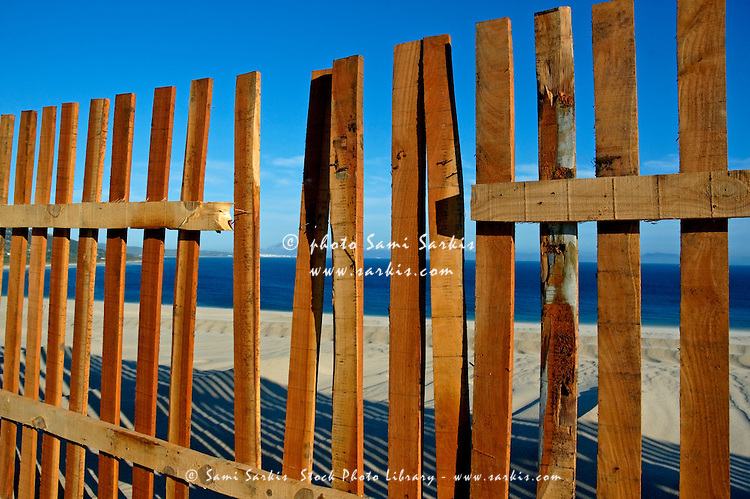Broken fence by the seaside, Tarifa, Andalusia, Spain.