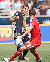 Sebastien Le Toux #9 of the Philadelphia Union nudges the ball past Dan Gargan #8 of Toronto FC during an MLS match at PPL stadium in Chester, PA. on July 17 2010. Union won 2-1 with a last minute penalty kick goal.