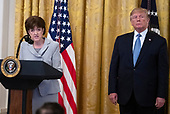 "Chair of the Council on Environmental Quality Mary Neumayr, left, makes remarks on ""America's Environmental Leadership"" as United States President Donald J. Trump, right, listens in the East Room of the White House in Washington, DC on Monday, July 8, 2019.<br />