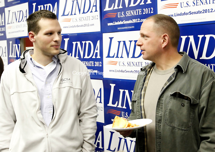 Torrington, CT-04 November 2012-110412CM19-  Jason Gentile, left, of New Hartford and Elliott Halpern of Harwinton, chat during a rally for Republican candidate for U.S. Senate, Linda McMahon, at her headquarters Sunday night in Torrington.  The event was held by the Torrington Republican Town Committee in support of McMahon.   Christopher Massa Republican-American