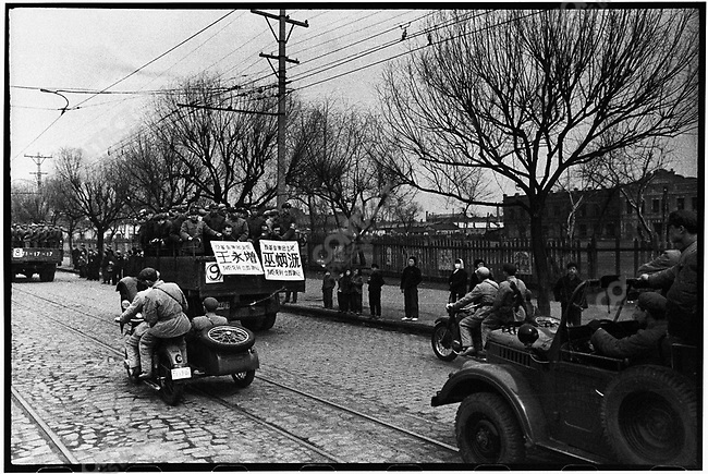 Following a public trial, seven men and one woman are transported in open trucks from Harbin to Huang Shan Cemetery on the city outskirts for execution. Harbin, 5 April 1968