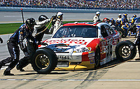Dave Blaney  makes a pit stop during the Aaron's 499 at Talladega Superspeedway, Talladega, AL, April 17, 2011.  (Photo by Brian Cleary/www.bcpix.com)