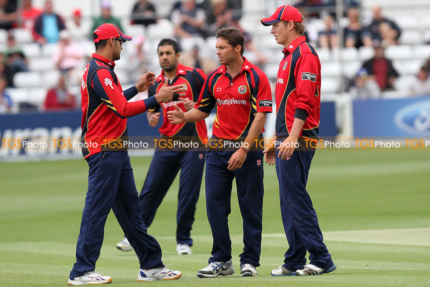 Greg Smith of Essex is congratulated on the wicket of Benny Howell - Essex Eagles vs Gloucestershire Gladiators - Clydesdale Bank CB40 Cricket at the Ford County Ground, Chelmsford, Essex - 04/06/12 - MANDATORY CREDIT: Gavin Ellis/TGSPHOTO - Self billing applies where appropriate - 0845 094 6026 - contact@tgsphoto.co.uk - NO UNPAID USE.