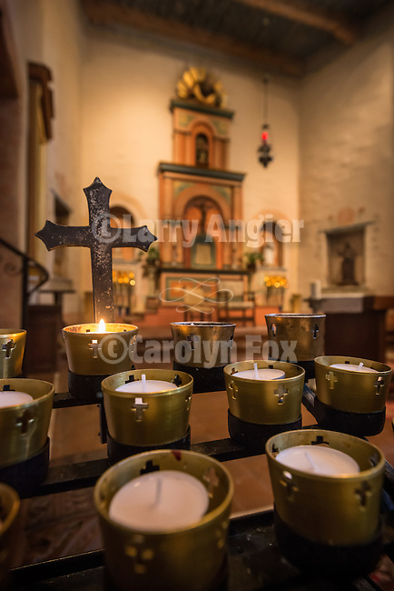Mission San Diego de Acala, California. First of the Alta California Missions, it was founded by Father Junipero Serra July 16, 1769.<br /> <br /> Chapel interior--altar and votive candles