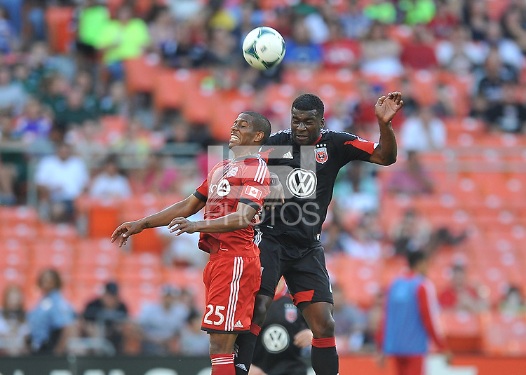 Brandon McDonald (4) of D.C. United head the ball against Jeremy Hall (25) of Toronto FC. Toronto FC defeated D.C. United 2-1, at RFK Stadium, Saturday June 15 , 2013.