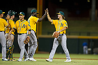 AZL Athletics center fielder Austin Beck (38) congratulates relief pitcher Rafael Kelly (48) after a victory against the AZL Cubs on August 9, 2017 at Sloan Park in Mesa, Arizona. AZL Athletics defeated the AZL Cubs 7-2. (Zachary Lucy/Four Seam Images)