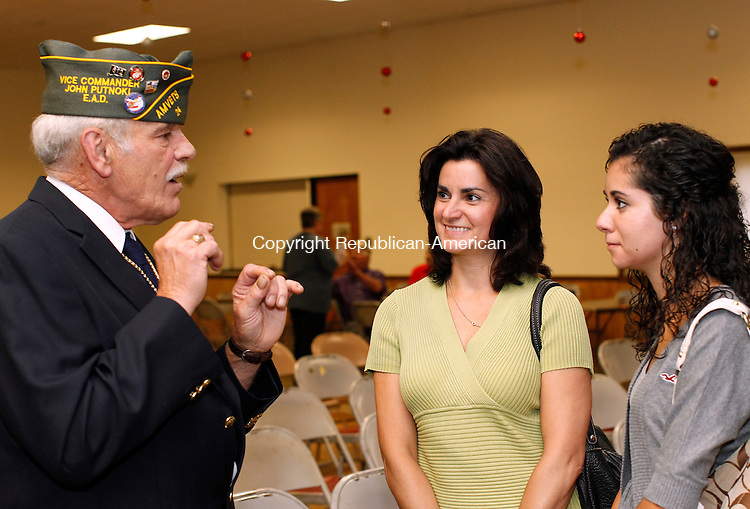 Torrington, CT-14, July 2010-071410CM04  Filomena Silva (right) and her mother, Maria, of Watertown  talks with John Putnoki, second vice of the AmVet (The American Veterans) Wednesday afternoon at the Knights of Columbus in Torrington.  Silva received the Julius F. Kovalaski Award. For the first time the AmVet's gave out four scholarships to local students.  Silva is planning on pursuing a Biology degree, then attend medical school.   --Christopher Massa Republican-American