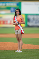 Christy Hinnant, Mrs. North Carolina America 2015, throws out a ceremonial first pitch prior to the Appalachian League game between the Bluefield Blue Jays and the Burlington Royals at Burlington Athletic Park on July 1, 2015 in Burlington, North Carolina.  The Royals defeated the Blue Jays 5-4. (Brian Westerholt/Four Seam Images)
