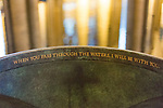 The contemporary font with water in Salisbury Cathedral in Wiltshire in England