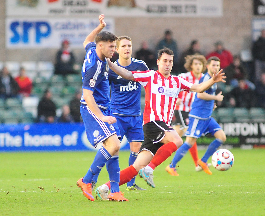 Lincoln City's Craig Stanley vies for possession with FC Halifax Town's Scott McManus<br /> <br /> Photographer Andrew Vaughan/CameraSport<br /> <br /> Football - Vanarama National League - Lincoln City v FC Halifax Town - Saturday 26th December 2015 - Sincil Bank - Lincoln<br /> <br /> &copy; CameraSport - 43 Linden Ave. Countesthorpe. Leicester. England. LE8 5PG - Tel: +44 (0) 116 277 4147 - admin@camerasport.com - www.camerasport.com