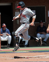 Maryland outfielder Tim Lewis (39) crosses home plate in the first inning of an NCAA college baseball tournament super regional game against Maryland in Charlottesville, Va., Saturday, June 7, 2014. Maryland defeated Virginia 5-4. (AP Photo/Andrew Shurtleff)