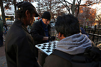 (171128RREI2290) La Esquina where Latinos have gathered for decades at the corner of Mt. Pleasant St. and Kenyon St. NW. to play checkers (damas). Washington DC.  Nov. 28 ,2017 . ©  Rick Reinhard  2017     email   rick@rickreinhard.com