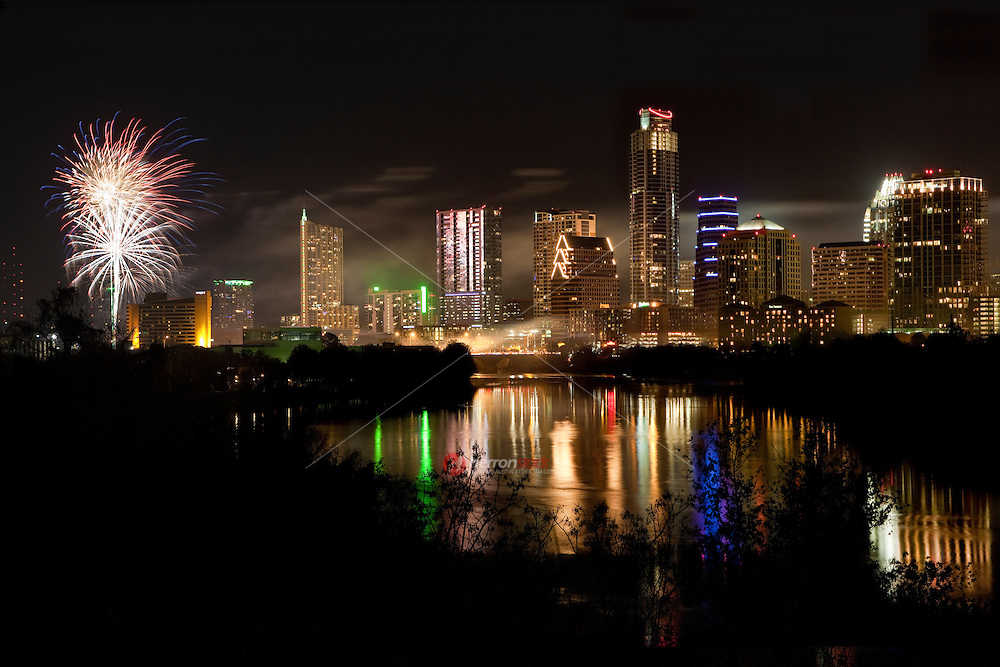 Colorful Fireworks light up the downtown sky during Austin's New Year's Eve Celebration  on Ladybird Lake in Austin, Texas