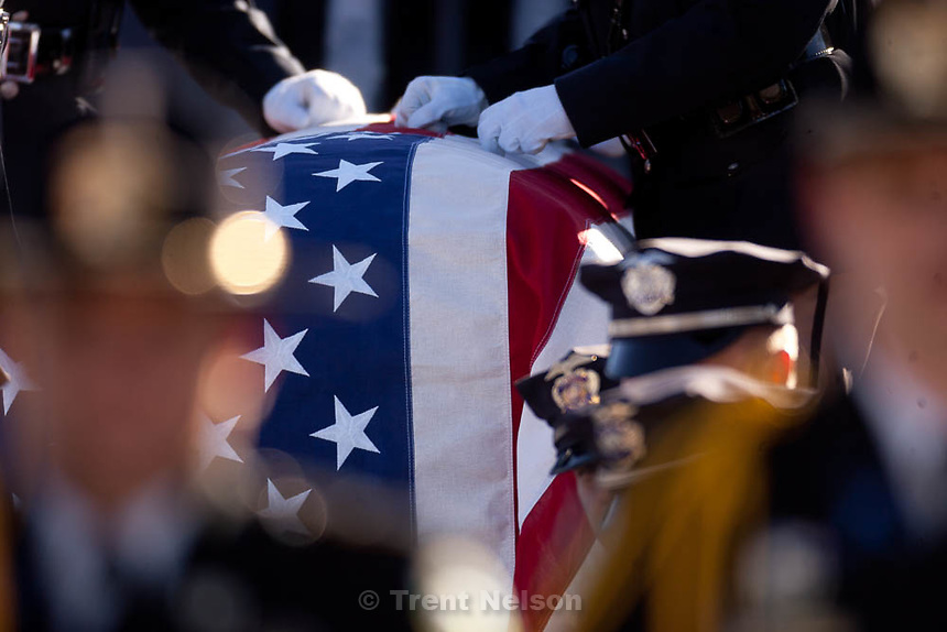 Trent Nelson  |  The Salt Lake Tribune.Honor guard and pallbearers with the casket at the graveside service at the Ogden City Cemetery for Ogden police Officer Jared Francom, in Ogden, Utah, Wednesday, January 11, 2012.