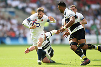 Elliot Daly of England fends Victor Vito of the Barbarians. Quilter Cup International match between England and the Barbarians on May 27, 2018 at Twickenham Stadium in London, England. Photo by: Patrick Khachfe / Onside Images