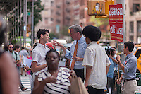 "New York Mayoral candidate and Public Advocate Bill DeBlasio, center, with his son Dante DeBlasio, right, does a ""meet and greet"" campaign event in front of the newly opened Fairway supermarket in the Chelsea neighborhood of New York on Tuesday, July 30, 2013. In the seemingly never ending battle for City Hall DeBlasio has been placed as number two behind Christine Quinn in recent polls.  (© Richard B. Levine)"