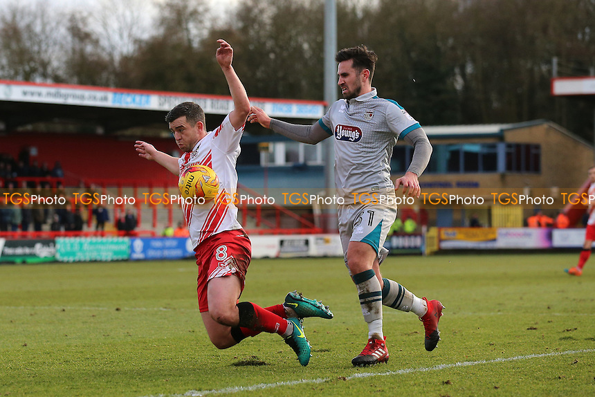 Steven Schumacher of Stevenage goes down under challenge from Chris Clements of Grimsby Town during Stevenage vs Grimsby Town, Sky Bet EFL League 2 Football at the Lamex Stadium on 28th January 2017