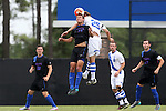 30 August 2015: DePaul's Austin Harrell (12) and Duke's Cody Brinkman (25) challenge for a header. The Duke University Blue Devils hosted the DePaul University Blue Demons at Koskinen Stadium in Durham, NC in a 2015 NCAA Division I Men's Soccer match.