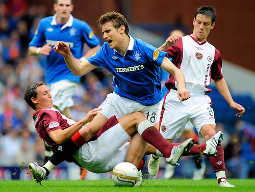 7TH MAY 2011, RANGERS V HEARTS, IBROX STADIUM, GLASGOW, EGGERT JONSSON FOUL ON NIKICA JELAVIC EARNS HIM A RED CARD, ROB CASEY PHOTOGRAPHY